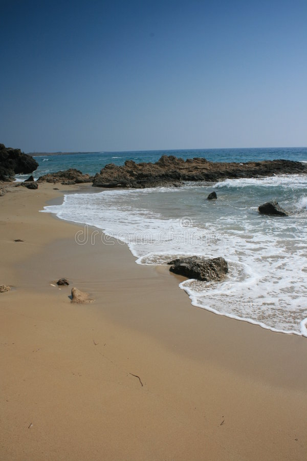 A rocky shore in Paphos royalty free stock images