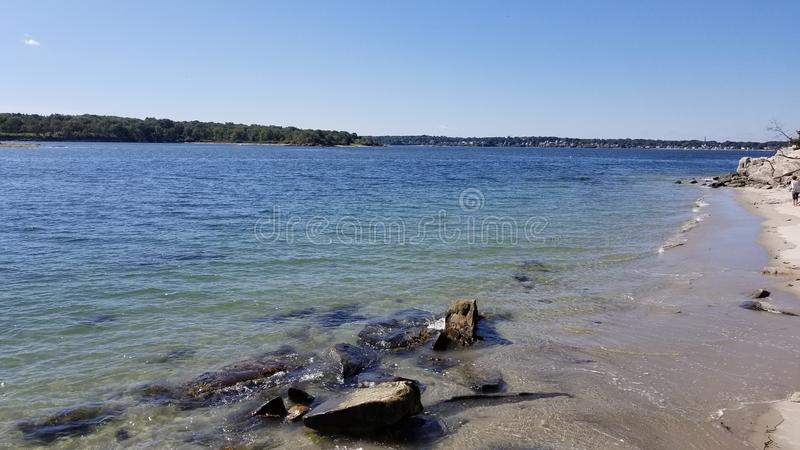 The rocky shore of Peaks Island stock photography