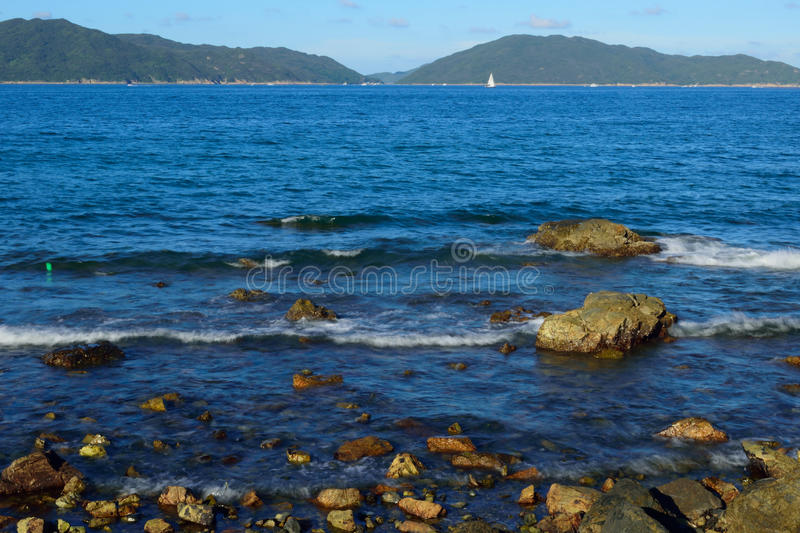 Rocky shore in Sai Kung. Taken in summer time royalty free stock images