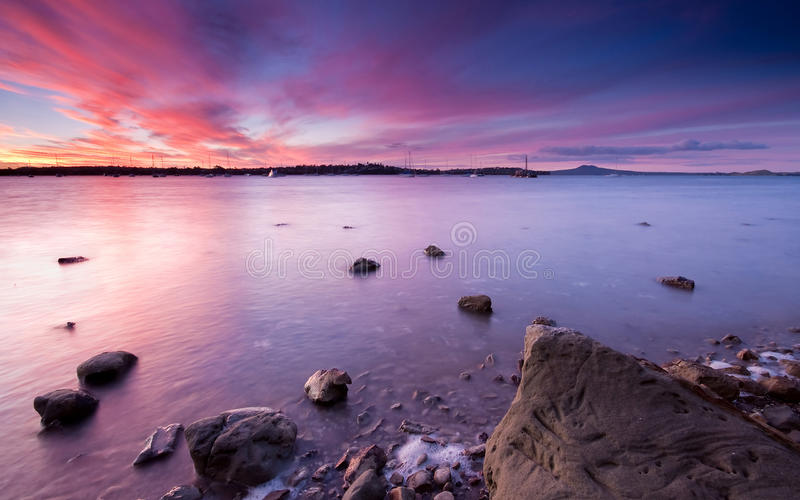 Download Rocky shore at sunset stock photo. Image of blue, water - 11016598