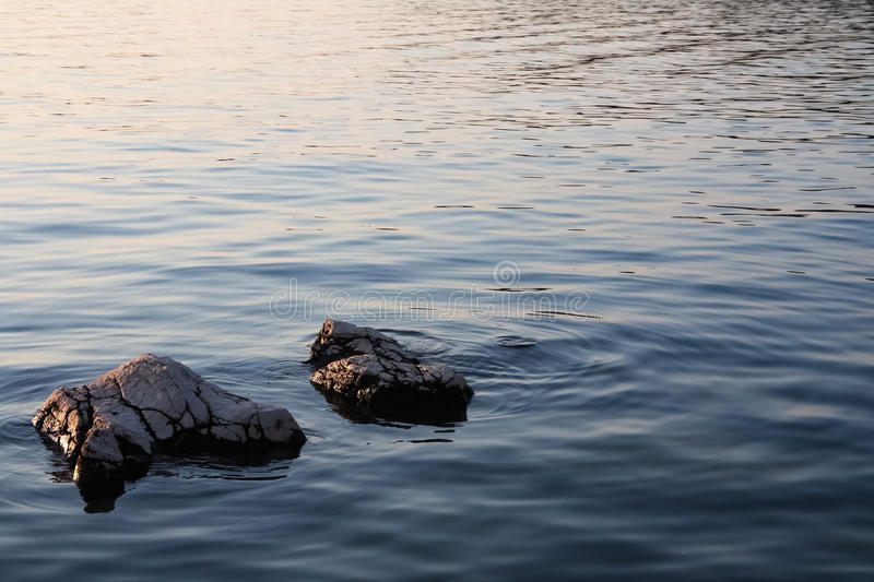 Rocky shore at sunset royalty free stock photos