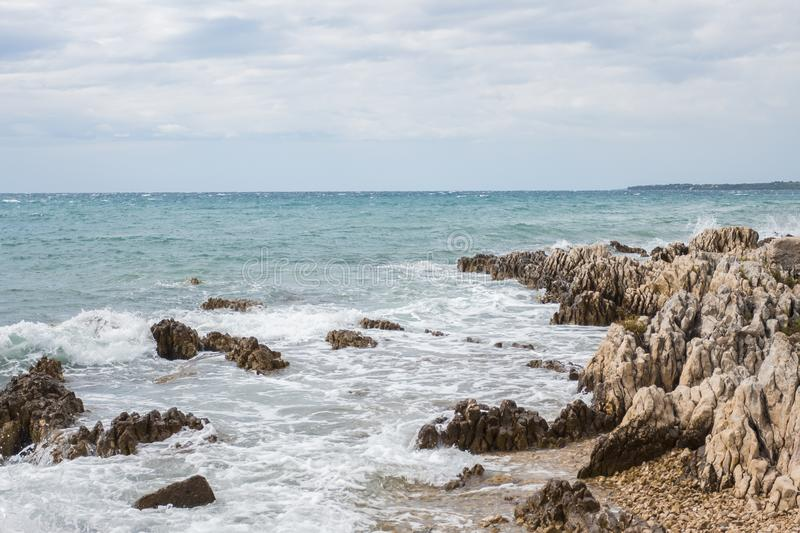 Rocky shore in Zadar Croatia with a view at medieterranean sea royalty free stock image