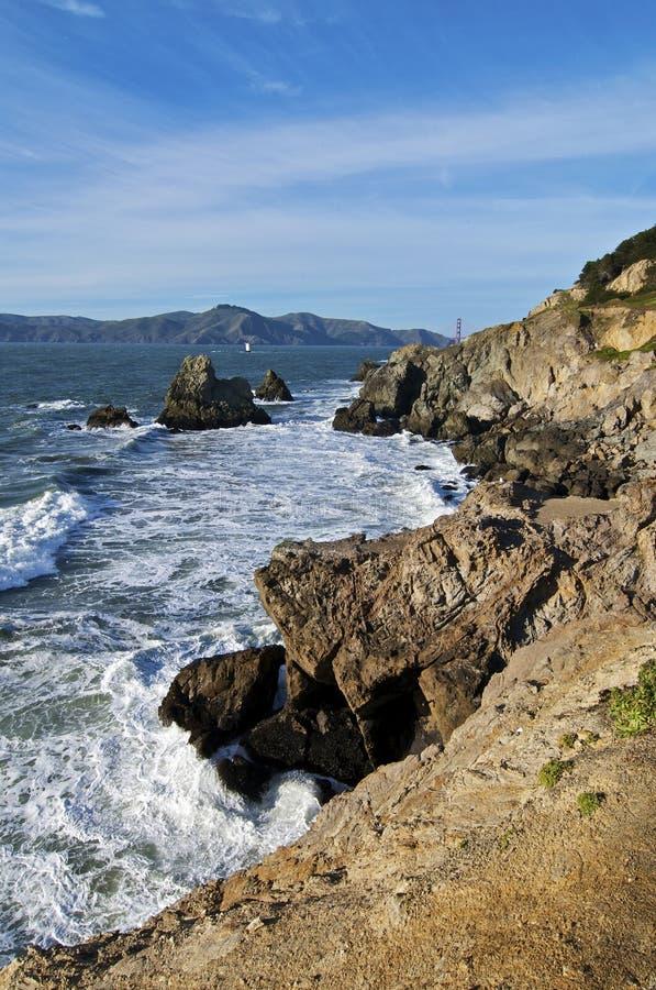 Rocky Shoreline. Ocean Waves Crash against a Rocky Shoreline stock images