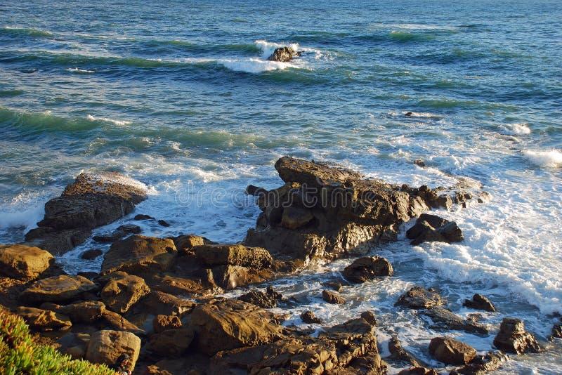 Rocky shoreline below Heisler Park, Laguna Beach, CA. Image shows the rocky shoreline below Heisler Park, Laguna Beach, California. Image taken during the winter royalty free stock photo