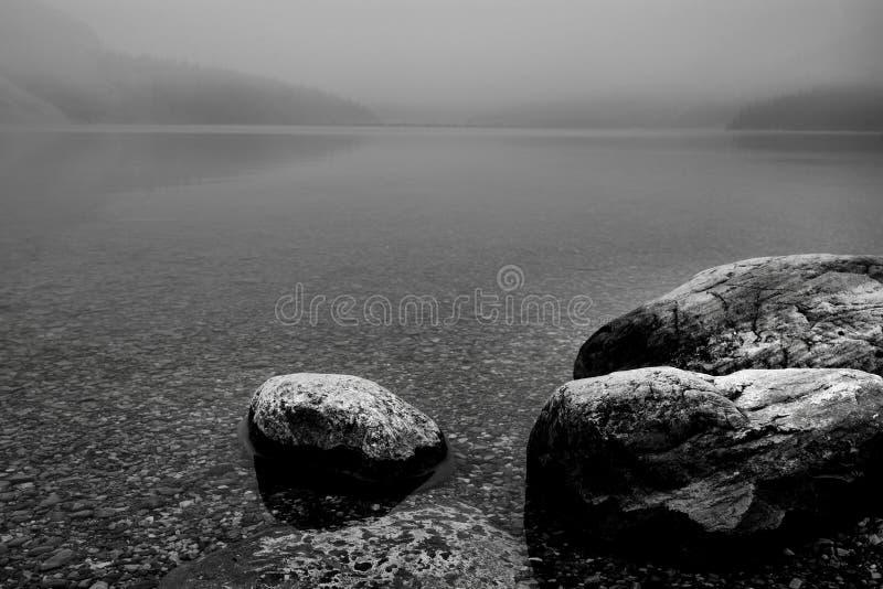 Rocky Shoreline Bow Lake. Landscape featuring a rocky shoreline from Bow Lake, which is located in Banff National Park stock photo