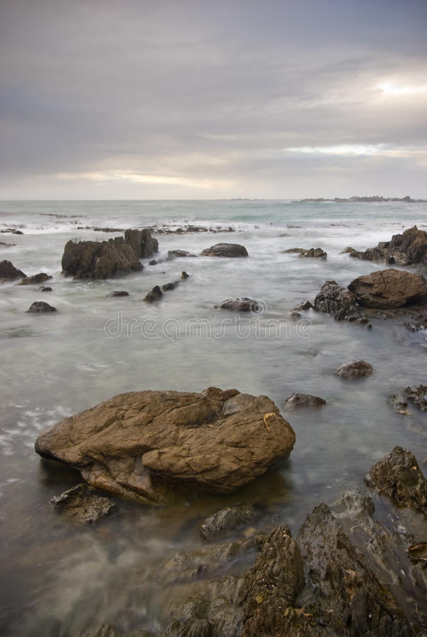 Download Rocky Shoreline With Clouds Stock Image - Image: 12382377
