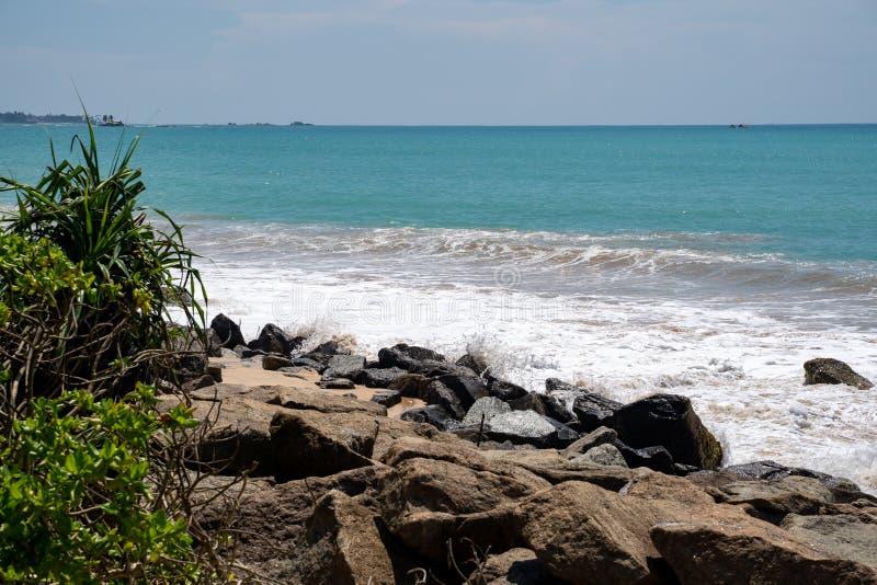 Rocky shoreline of the Indian Ocean in Sri Lanka royalty free stock photography