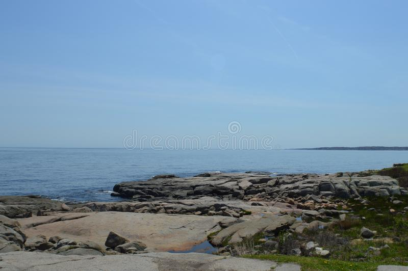Rocky Shoreline. The rocky shoreline of Maine overlooks the Atlantic Ocean stock photo