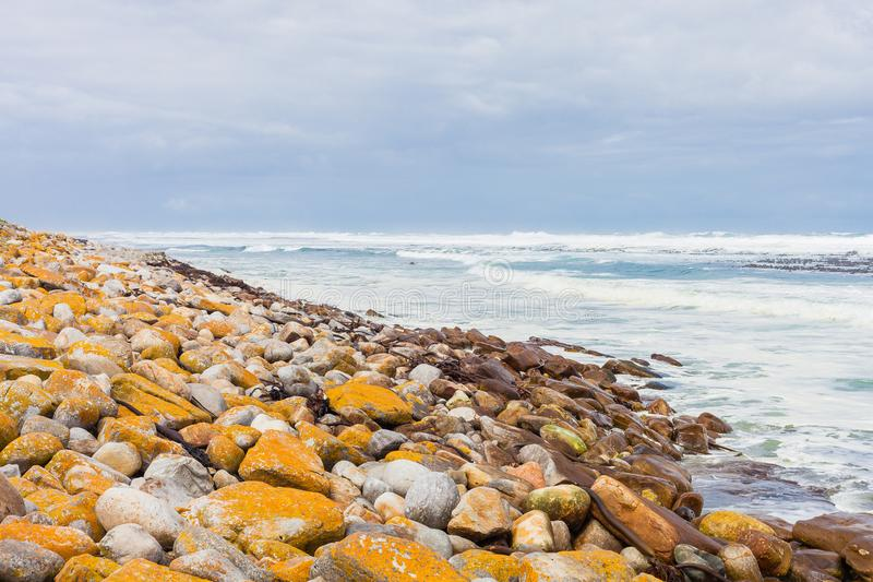 Rocky shoreline on a rough coastline seaside in Cape Town South royalty free stock images