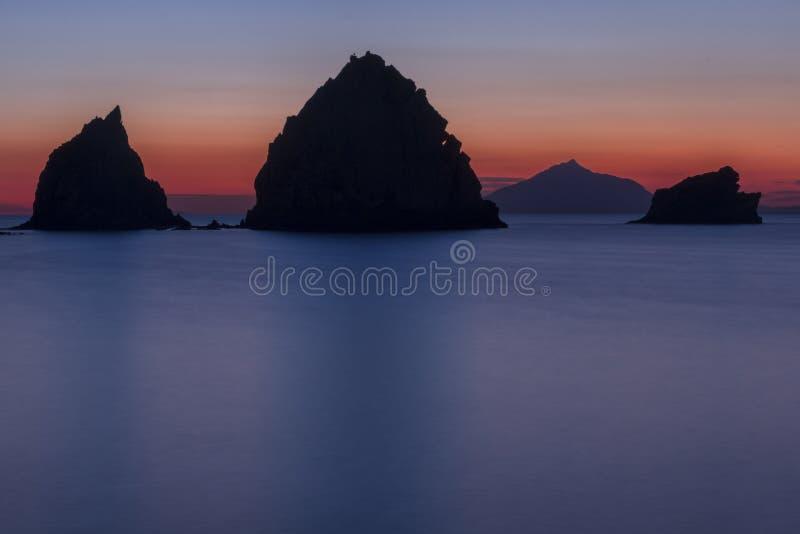 Rocky silhouettes in the Aegean Sea. stock photos