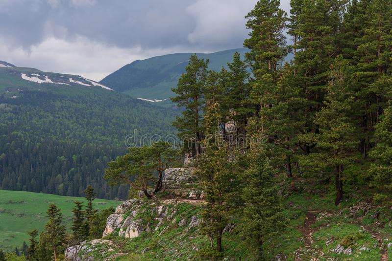 The rocky slope in the background of the gentle mountains royalty free stock photos