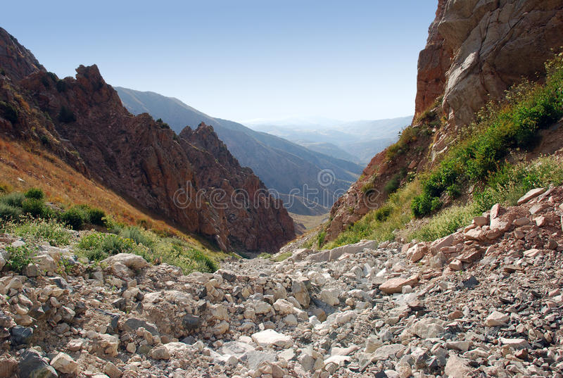 Rocky slope - channel in the Tien-Shan stock images