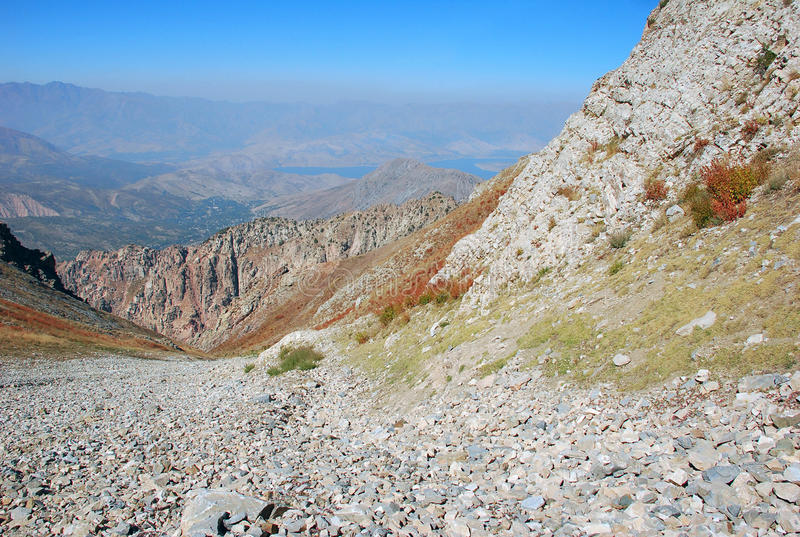 Rocky slope - channel in the Tien Shan mountains stock image