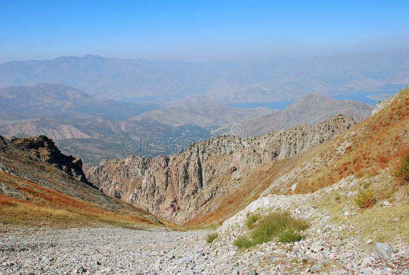 Rocky slope with mountains in Uzbekistan stock photography