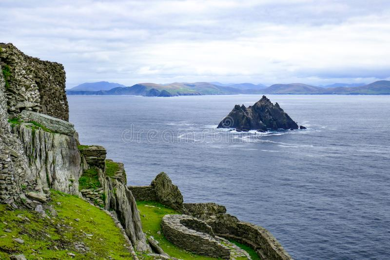 Rocky steep Little Skellig Island in the Atlantic Ocean, off of Ireland, as seen from Skellig Michael Island, larger of the two. royalty free stock photos