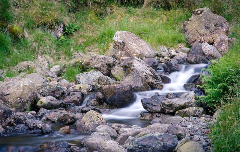 Rocky stream on a slope stock image