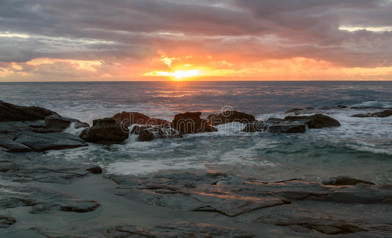 Download Rocky Sunrise Seascape stock image. Image of rock, dusk - 91222481