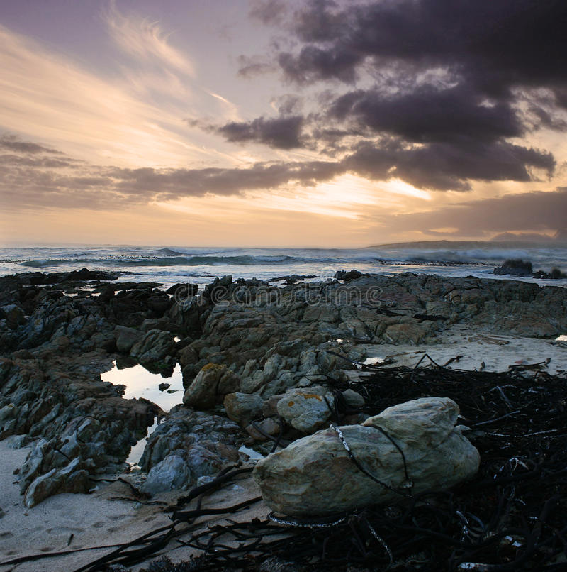 Rocky beach with sunset royalty free stock photos