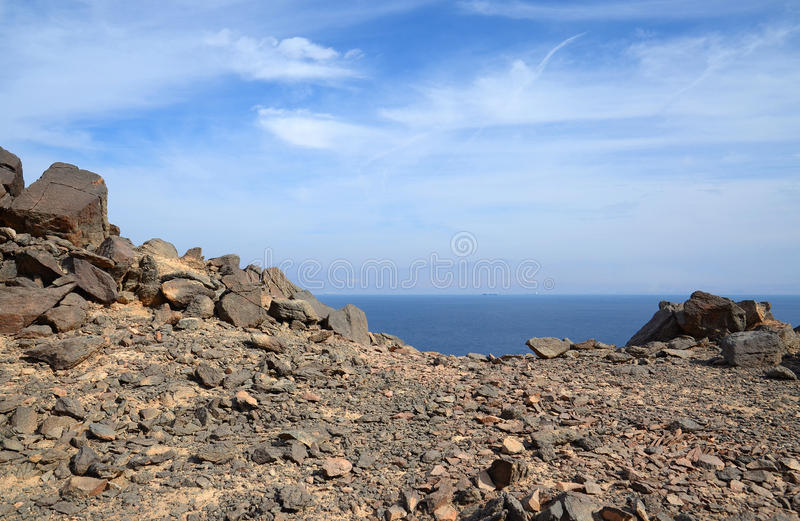 Rocky terrain on a background of sea and sky stock photos