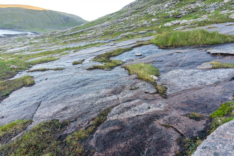 Rocky terrain and vegetation on the island of Mageroya, Norway. Rocky terrain and vegetation on the Mageroya island, Norway royalty free stock image