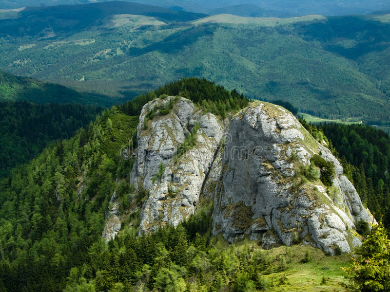Rocky tower in mountain stock images