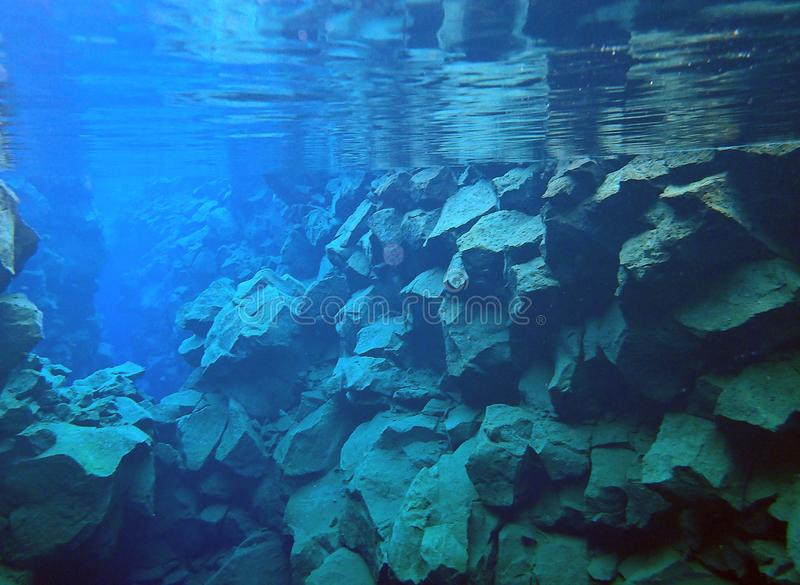 Rocky underwater rift between tectonic plates royalty free stock photography