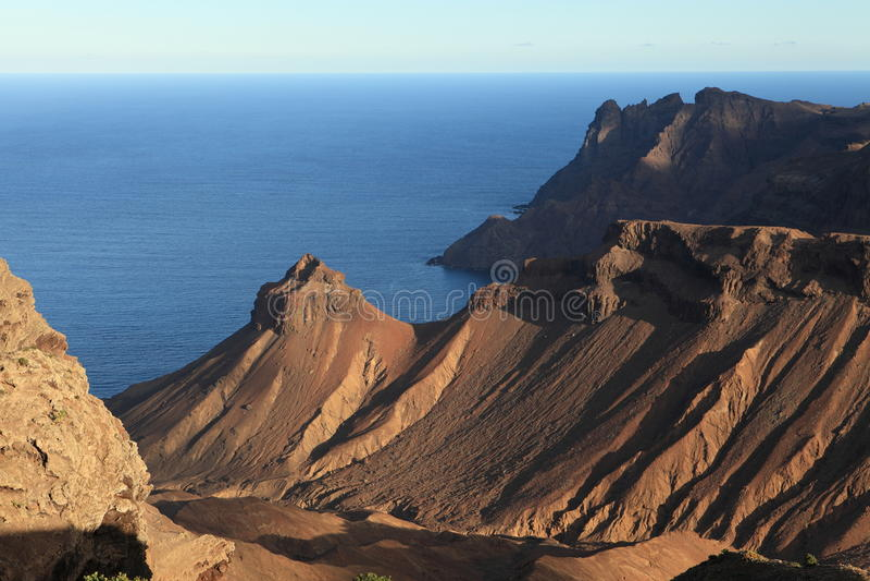 Rocky volcanic coastline of St Helena Island royalty free stock photo