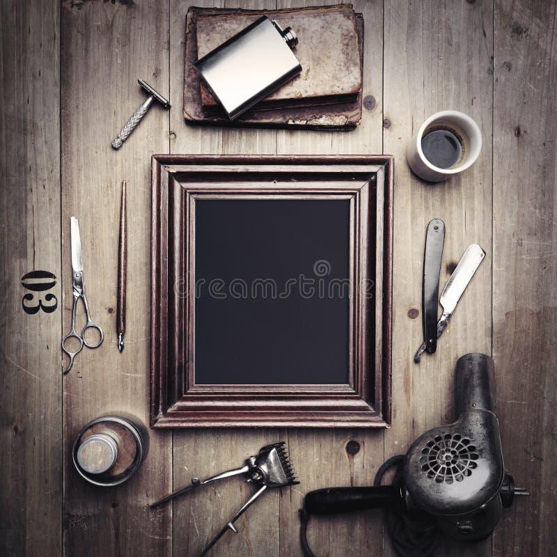 Roczników narzędzia fryzjer męski z obrazek ramą zdjęcie royalty free