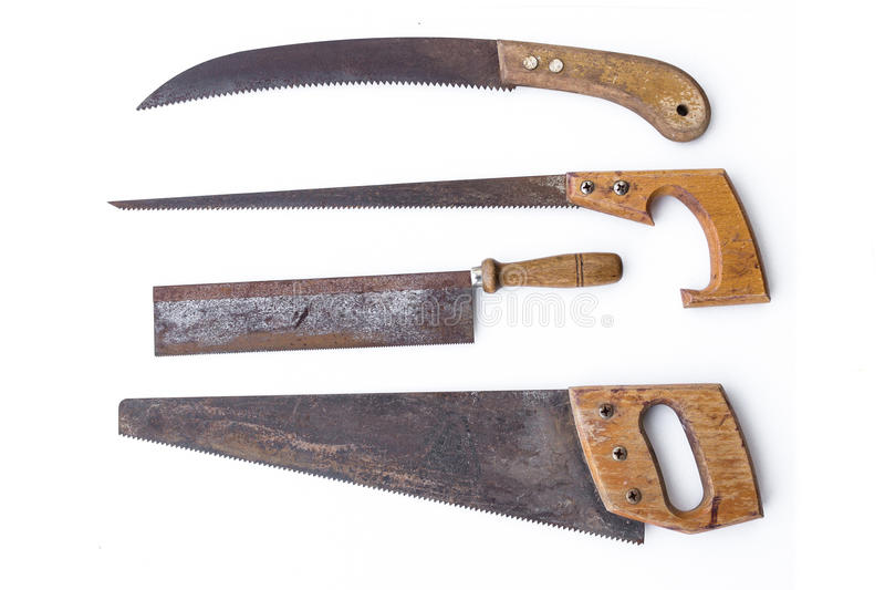 Roczników narzędzia - ustalone stare piły, handsaws odizolowywający fotografia stock