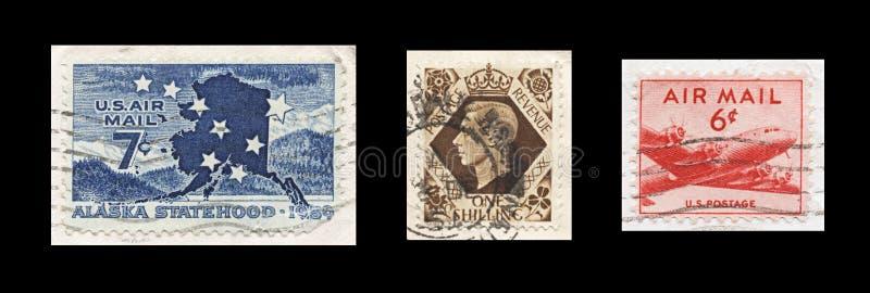 Roczników 1950s Lotniczej poczta znaczki na czerni obraz stock