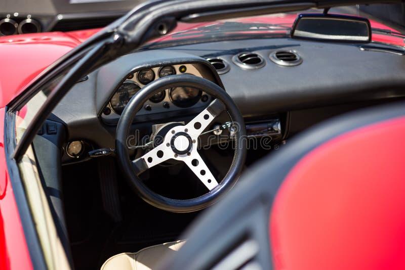 Roczników sportów samochodu kierownica zdjęcia royalty free