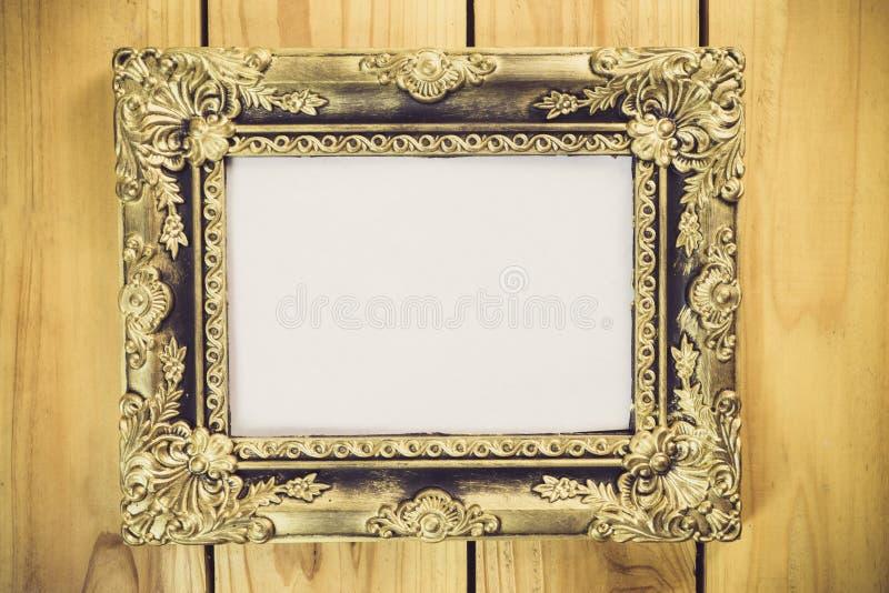 Rocznik fotografii rama na drewnianym stole fotografia royalty free