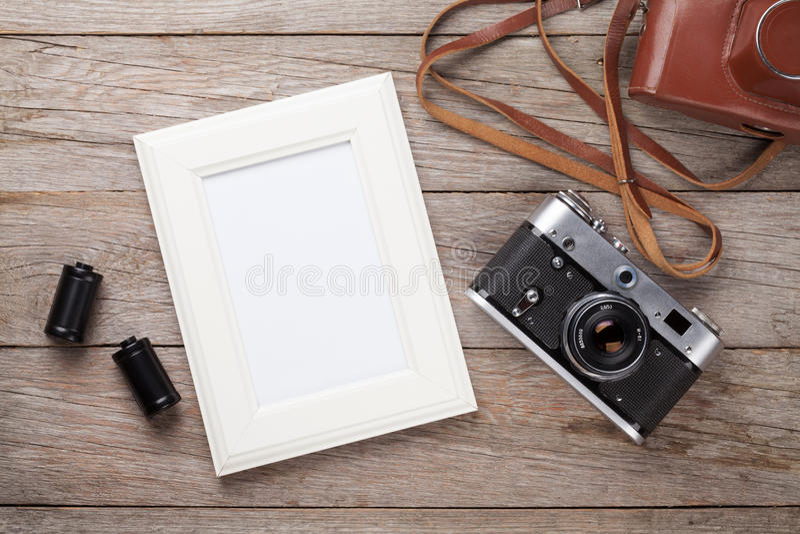 Rocznik kamery i puste miejsce fotografii ekranowa rama obrazy stock