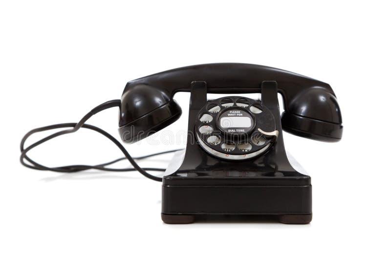 Rocznik, na biały tle czerń telefon zdjęcia royalty free