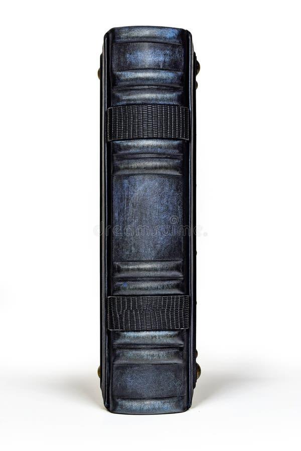 Rocznik skóry błękitna książka z nastroszonymi ziobro obraz stock