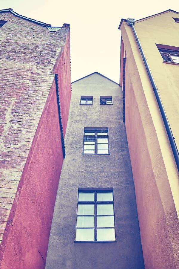 Rocznik stylizował stare budynek fasady w Toruńskim, Polska zdjęcie royalty free