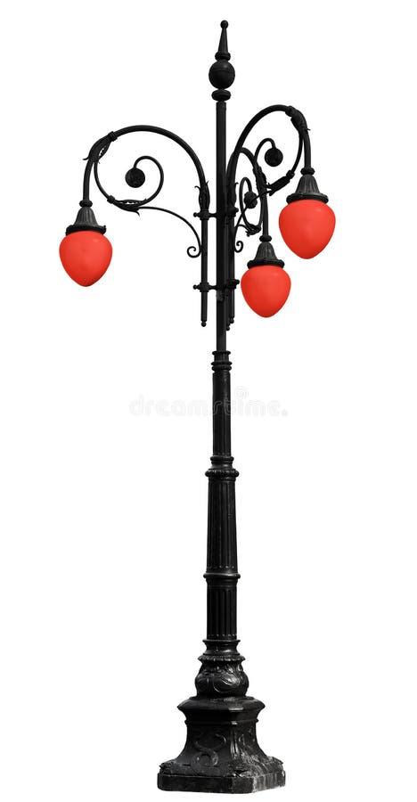Rocznika żelazny lamppost z czerwonym światłem odizolowywającym na bielu zdjęcia stock
