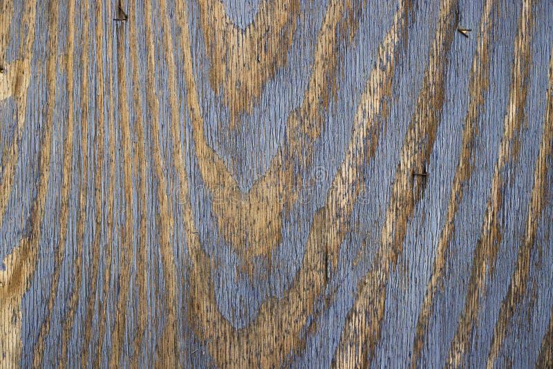 Rocznika drewniany t?o z b??kitn? koloru obierania farb? fotografia stock