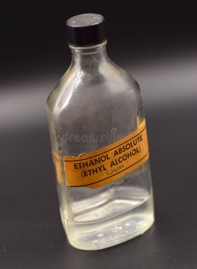 Rocznika etanolu butelka na Czarnym tle fotografia royalty free
