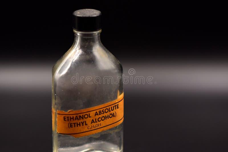 Rocznika etanolu butelka na Czarnym tle obraz royalty free