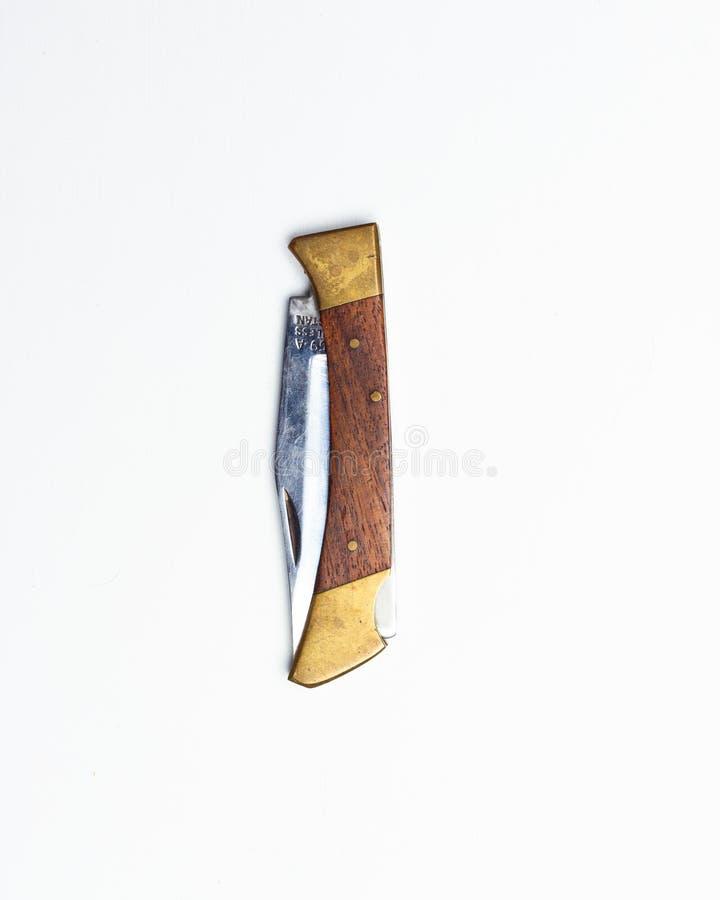 Rocznika falcowania nóż odizolowywający na białym tle obrazy stock