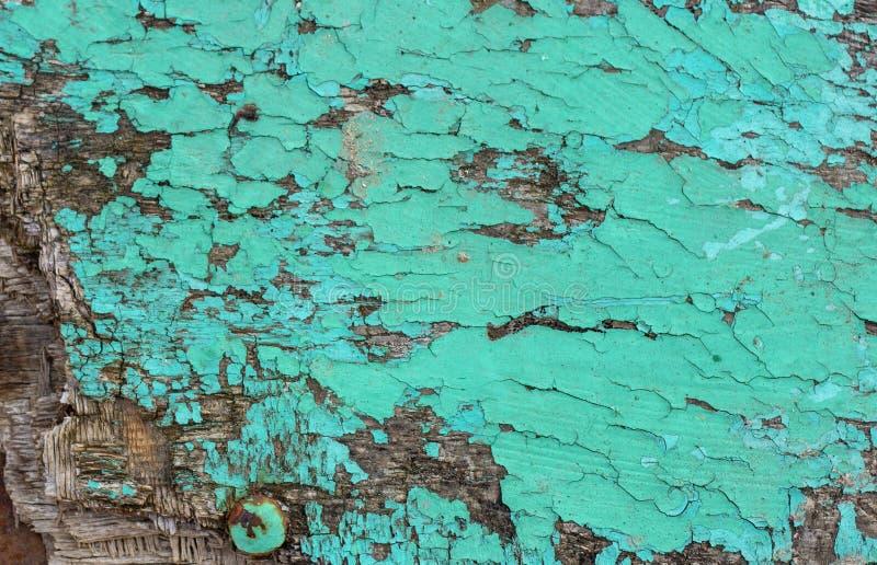 Rocznika grunge nieociosany drewniany textured tło z zielonym kolorem pękającym wietrzał farbę i narysy obraz royalty free