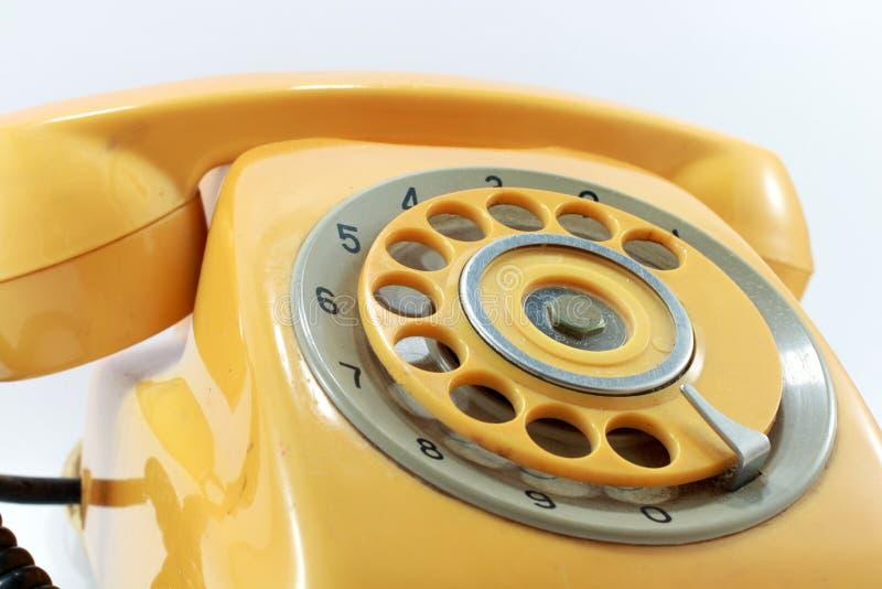 Rocznika koloru żółtego telefon fotografia stock
