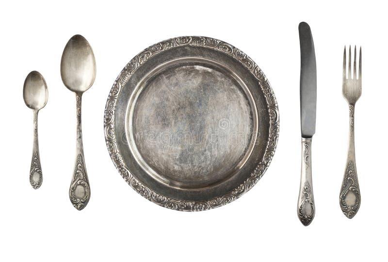 Rocznika metalu antyka talerz, łyżka i rozwidlenie odizolowywający na białym tle, zdjęcie stock