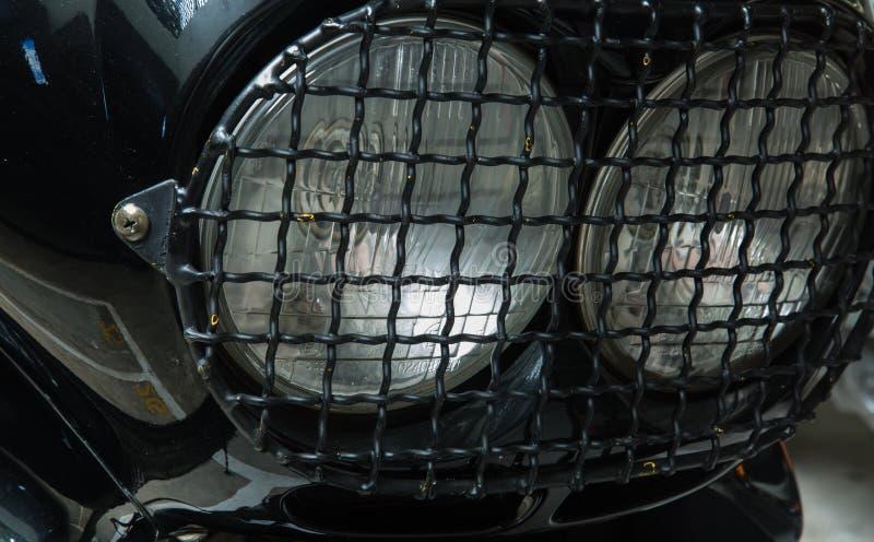 Rocznika motocyklu reflektoru zbliżenia stylowy widok obraz royalty free