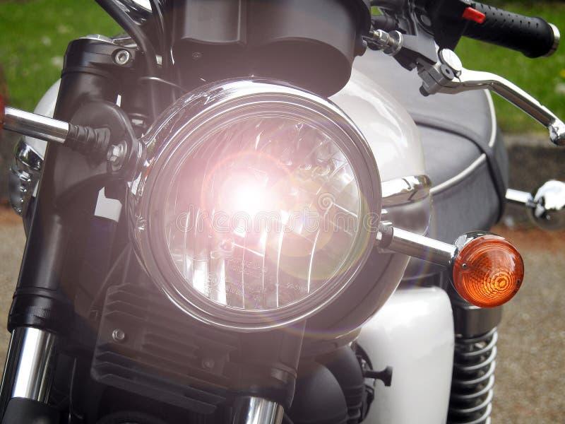 Rocznika motocyklu motocyklu triumfu Bonneville headlamp światło zdjęcie royalty free