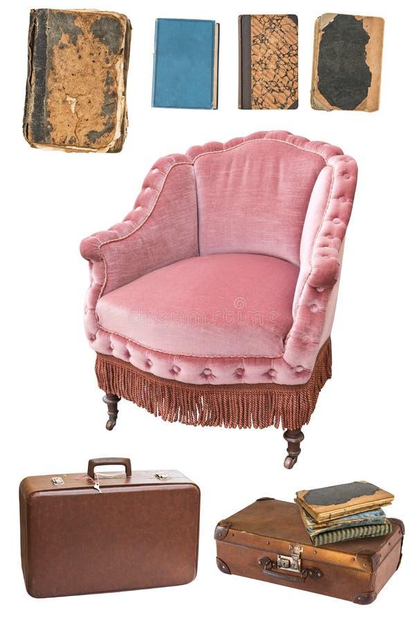 Rocznika różowy karło, książki, walizki odizolowywać na białym tle fotografia stock