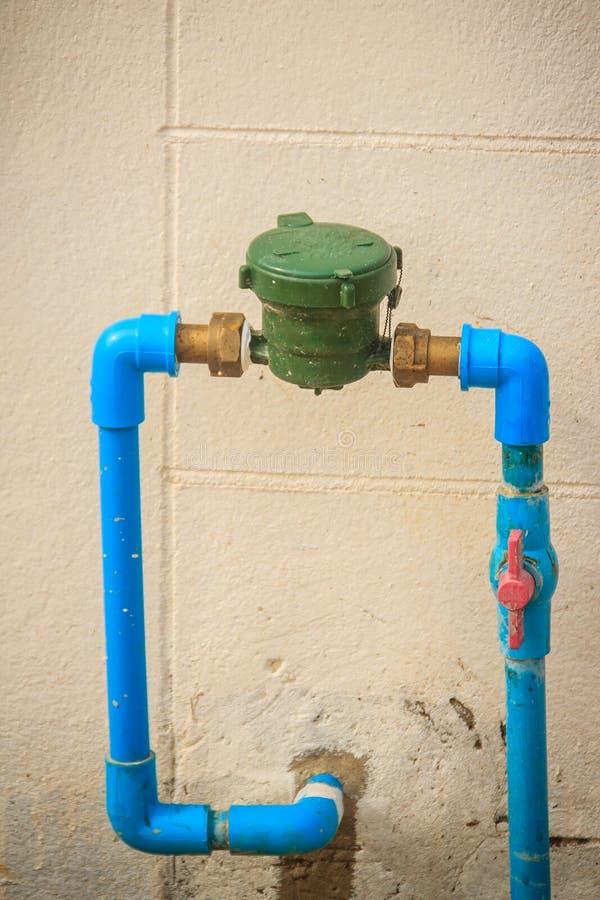 Rocznika wodny metr instalujący z brązu złączem, PVC łokcia conne fotografia royalty free
