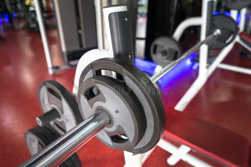 Rod and weights in the gym stock photos
