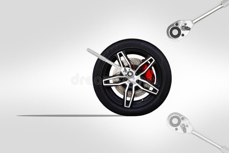 Roda preta do carro de competência com alterado com a chave de chave inglesa da catraca do cromo ilustração royalty free